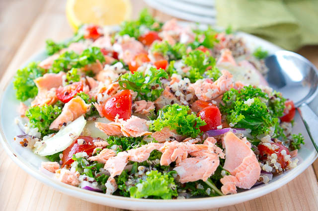 Delicious Salmon Quinoa and Kale Salad that is bursting with flavor and healthy ingredients. Perfect weeknight dinner - 15 min. to cook and easy prep work.