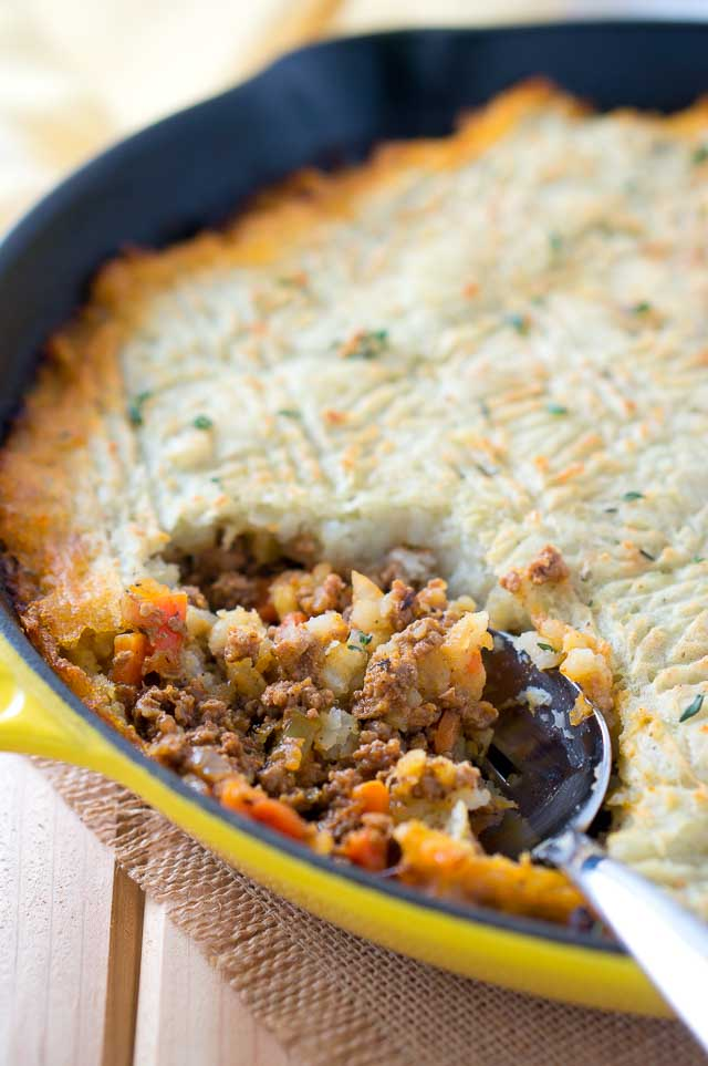 Easy Skillet Shepherd's Pie - a deliciously rich and hearty beef and vegetables meal covered with a blanket of mashed potatoes and baked to perfection.
