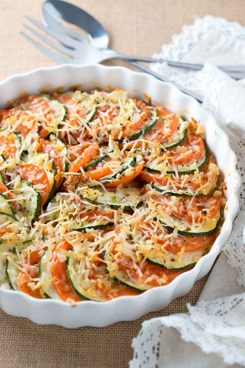 Parmesan Zucchini and Tomato Gratin - Thinly sliced zucchini and tomatoes, layered and baked with onion & garlic and topped with shredded parmesan.