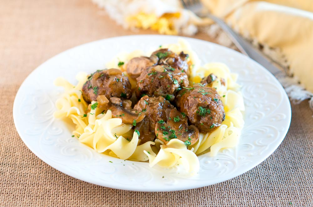 Salisbury Steak Meatballs w/ Mushroom Gravy is a great dinner idea for busy weeknights. It comes together in 30 minutes - so delicious & comforting!