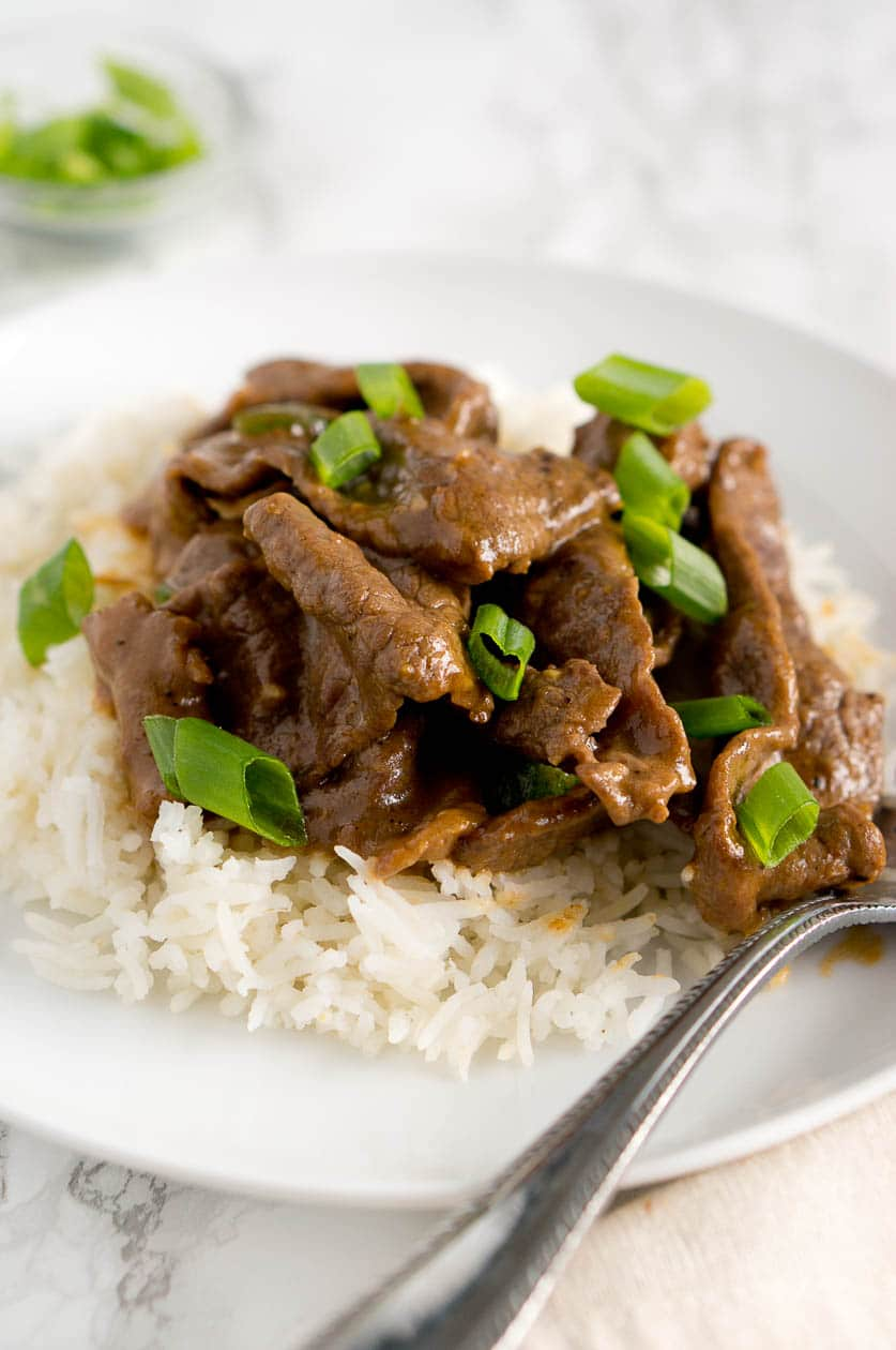 Authentic Mongolian Beef recipe made healthy. It's very easy to prepare and takes only about 5 minutes to cook and 20 minutes to marinate the steak.