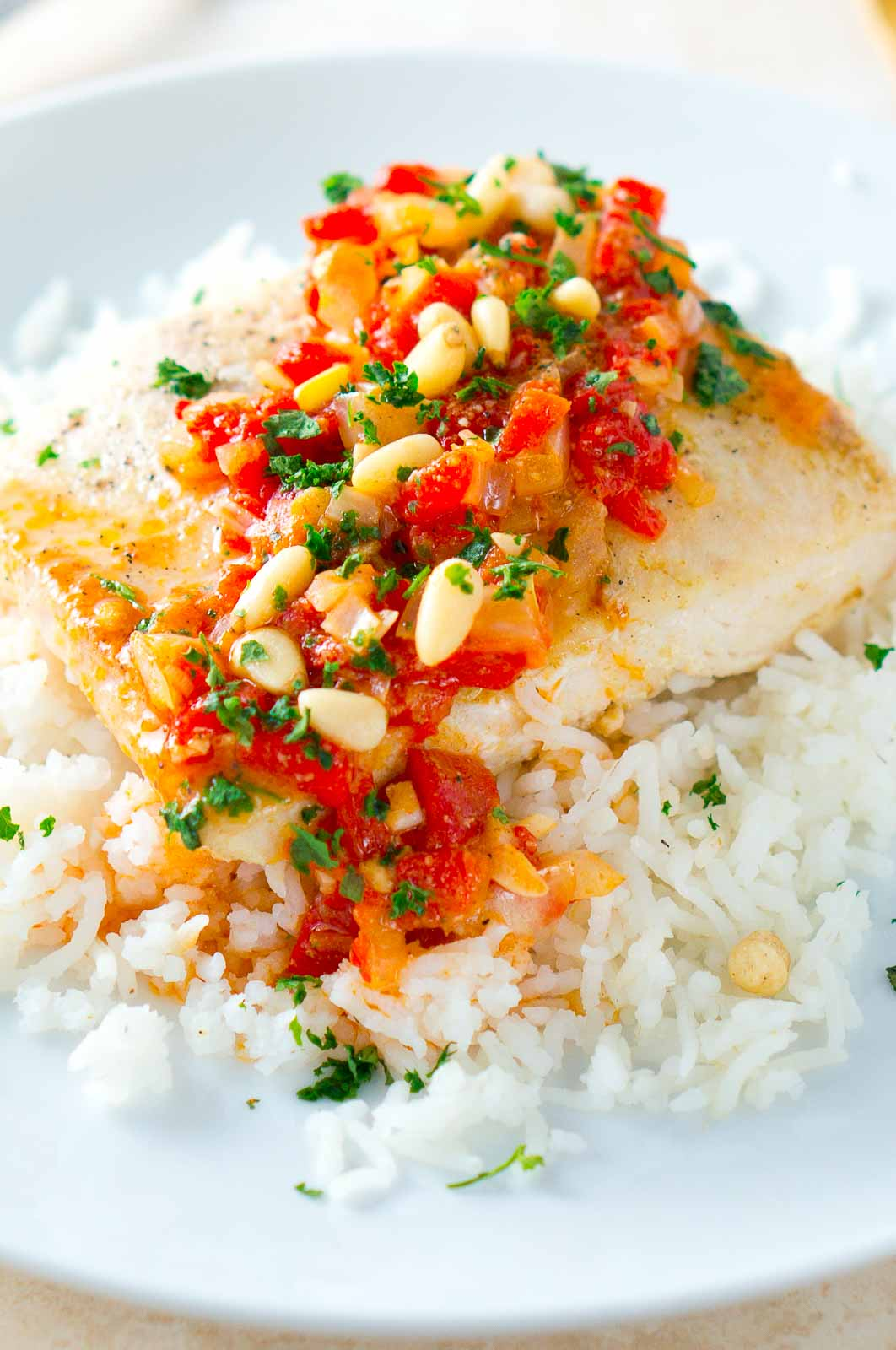Mahi Mahi is cooked to perfection and served on a bed of fragrant jasmine rice with a warm and delicious roasted pepper butter sauce.